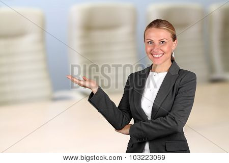 Smiling Business Woman Presenting. Welcome!