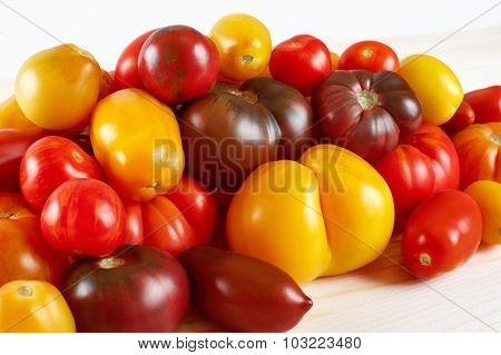 Tomatoes On A Light Background. Selection Grade.