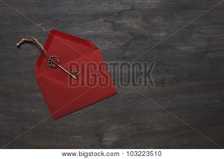 Red Envelope On Wood Background With Key