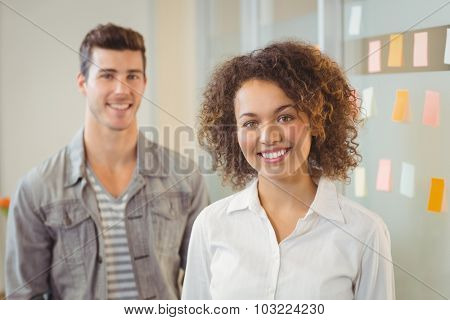 Portrait of smiling confident business people increative office