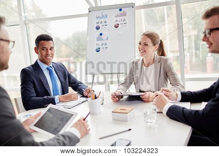 Happy employees listening to their colleague explanation