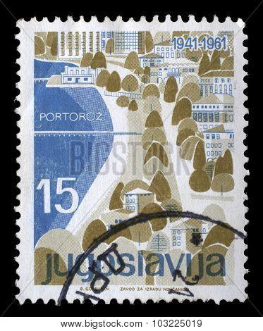 YUGOSLAVIA - CIRCA 1961: A stamp printed in Yugoslavia from the Local Tourism issue shows Portoroz, Slovenia, circa 1961.