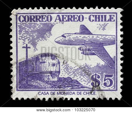 CHILE - CIRCA 1950s: A stamp printed in Chile shows plane on the background of trane, circa 1950s