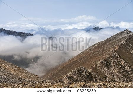 Peaks Of Mountains Above The Clouds