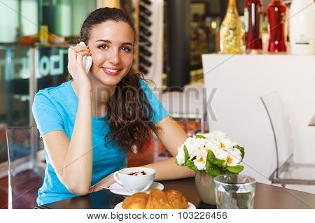 Smiling Girl Drinking A Cappuccino And Having A Call With Her Smart Phone