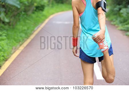 young asian woman runner warm up outdoor