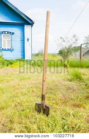 Old Metal Shovel On The Ground In The Garden