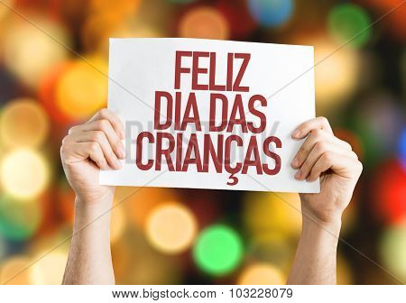 Happy Childrens Day (in Portuguese) placard with bokeh background