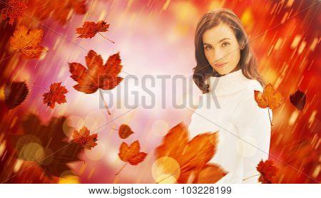 Pretty brunette in white jumper posing against dark abstract light spot design