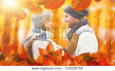 Young winter couple against view of a forest in the mist