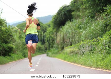 trail runner athlete running on forest trail