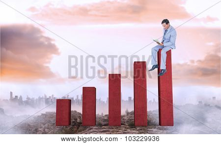 Businessman reading book while sitting over white background against bar chart depicting growth