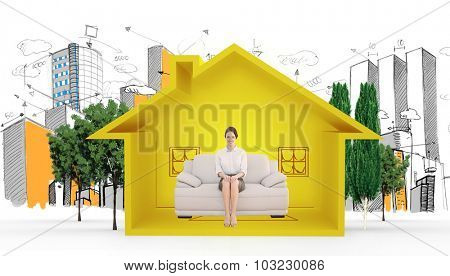 Smiling well dressed woman sitting on sofa against house shape with living room sketch
