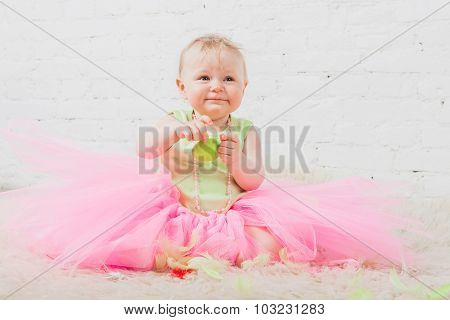 Beautiful baby girl sitting on fur