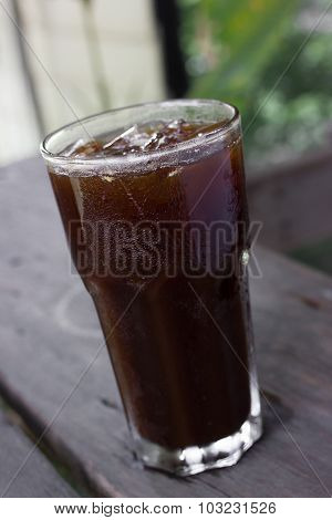 Ice Black Coffee On Wooden Table