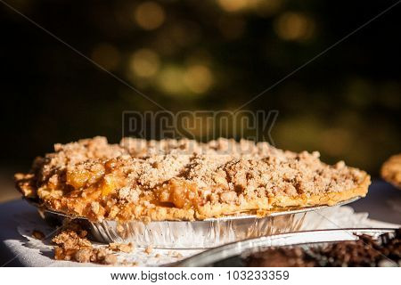 close up of apple pie crumble crust