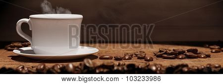Panorama with cup of fresh coffee with coffee beans and copy space (3D Rendering)