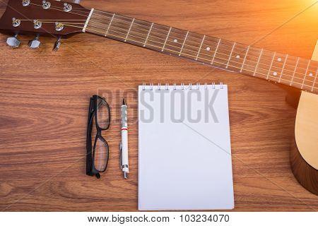 Guitar Notebook, Pencil And Eyeglasses