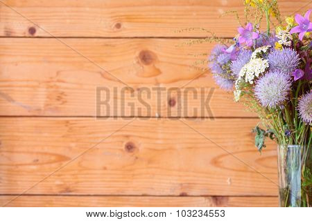 Purple flowers on a background of wooden boards