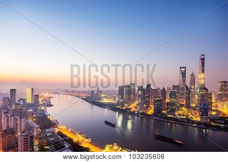 skyscrapers of the city in China surrounded by a river at dusk