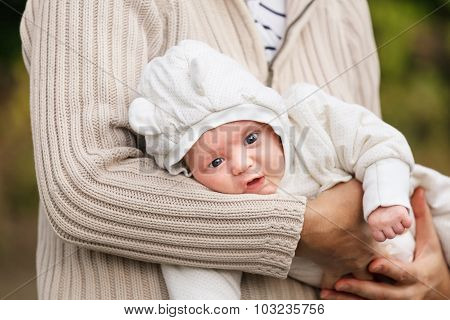 Old Woman Holding Her Grandson