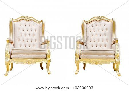 two luxury leather chairs with golden decorated edge