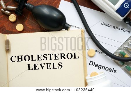 Cholesterol levels written on a book.