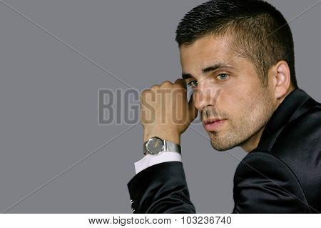 handsome young man wears a watch