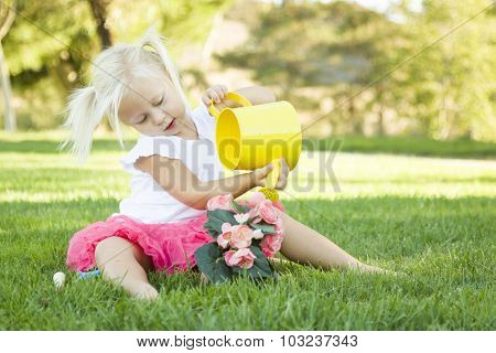 Cute Little Girl Playing Gardener with Her Tools and Flower Pot.