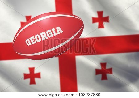 Georgia rugby ball against georgian flag with red cross symbols
