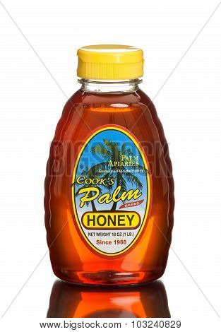 MIAMI, USA - March 30, 2015: A 1 lb. jar of Florida's Finest Honey Cook's Palm Brand Honey.