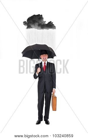 Business man with a rainy black cloud over him
