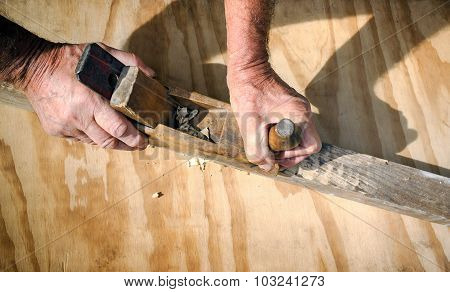 Carpenter's Hands Working With The Old Wooden Jointer