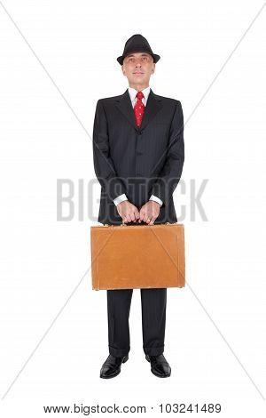 Businessman holding brown briefcase