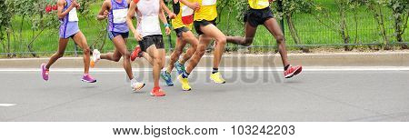 fitness marathon runners running on city road
