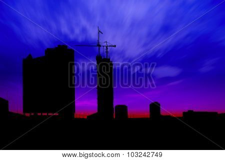 Dark twilight and silhouette construction city