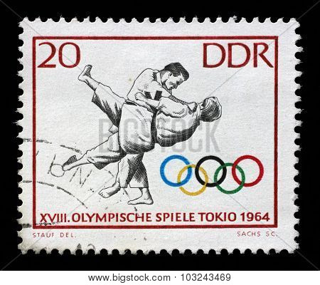 GDR - CIRCA 1964: A stamp printed in GDR shows Judo, 18th Olympic Games, Tokyo 64, circa 1964