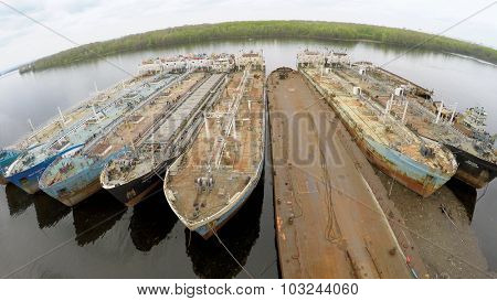 SAMARA - MAY 10, 2015: Nine tankers on moorage in Volga river at spring cloudy day. Aerial view video frame