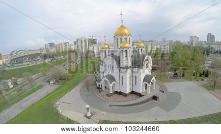 SAMARA - MAY 05, 2015: Cathedral of St. George near residential houses at spring cloudy day. Aerial view video frame