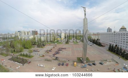 SAMARA - MAY 05, 2015: Crowd people are on Glory Square near Glory Monument at spring day. Aerial view video frame