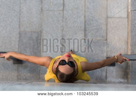 Top view of fashion girl in yellow dress