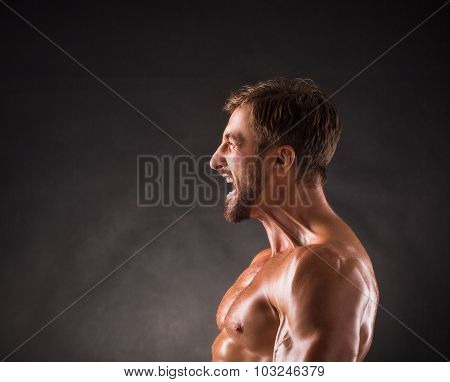 Screaming shirtless mascular man