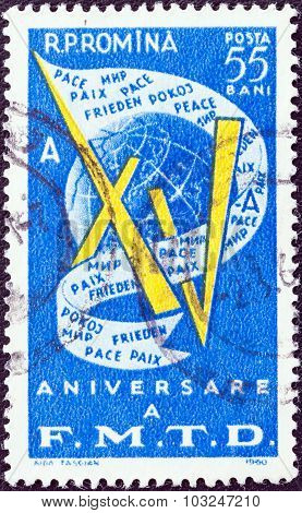 ROMANIA - CIRCA 1960: A stamp printed in Romania shows XV, Globe and Peace Banner
