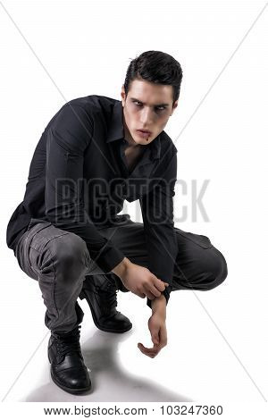 Portrait of a Young Vampire Man with Black Shirt Sitting on Floor