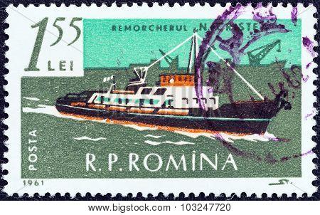 ROMANIA - CIRCA 1961: A stamp printed in Romania shows tug N. Cristea