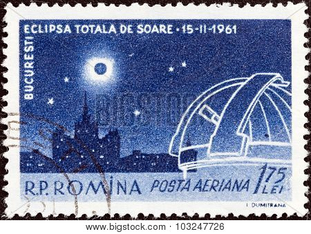 ROMANIA - CIRCA 1961: Stamp shows Eclipse over Scanteia Building and Observatory
