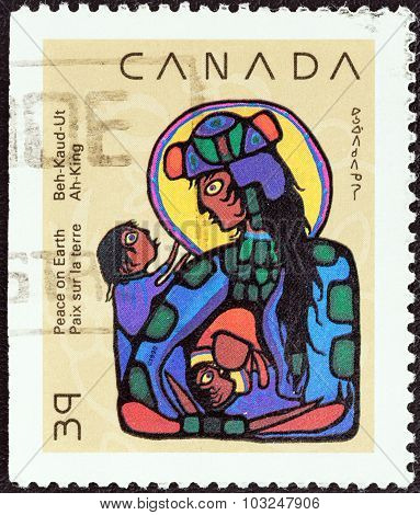 CANADA - CIRCA 1990: Stamp shows Virgin Mary with Christ Child and St. John the Baptist