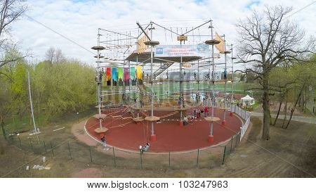 MOSCOW - MAY 04, 2015: Many young people get fun on Tall Rope Park Skytown in VDNH at spring cloudy day. Aerial view video frame