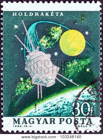 HUNGARY - CIRCA 1963: A stamp printed in Hungary shows Moon rocket