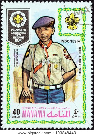 MANAMA DEPENDENCY - CIRCA 1971: Stamp shows boy scout from Indonesia